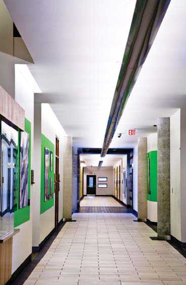 A good example of colour contrast and width in a hallway. The central overhead lighting is also useful for wayfinding.
